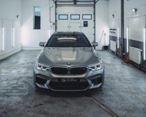 silver bmw car inside modern style garage