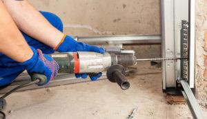 specialist repairing commercial garage door
