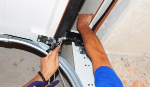 specialist repairing garage door